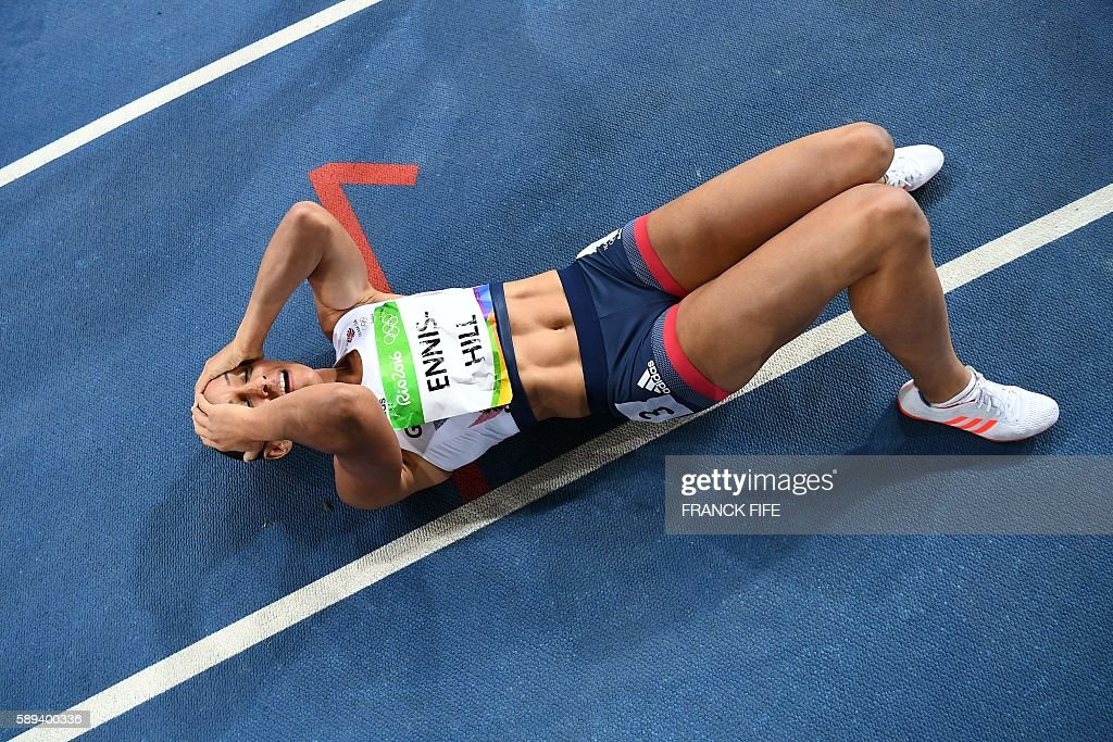 TOPSHOT - Silver medallist Britain's Jessica Ennis-Hill reacts after the Women's Heptathlon 800M during the athletics event at the Rio 2016 Olympic Games at the Olympic Stadium in Rio de Janeiro on August 13, 2016. / AFP / FRANCK