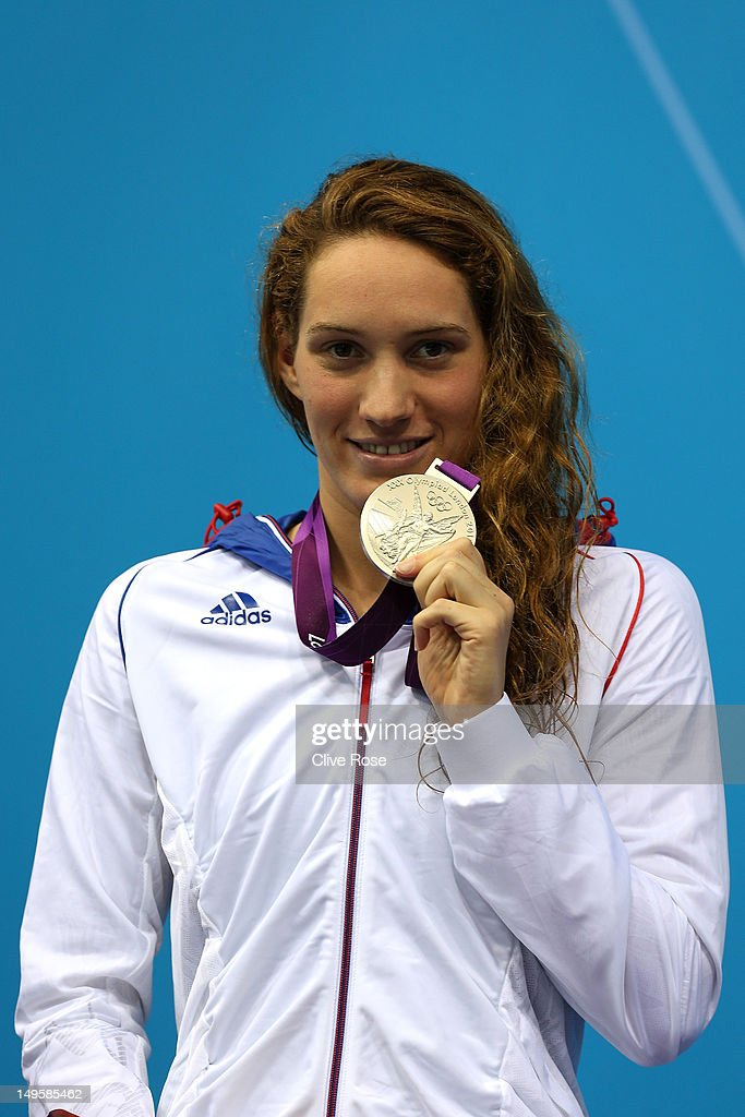Silver medallist Camille Muffat of France poses on the podium during the medal ceremony for the Women's 200m Freestyle final on Day 4 of the London...