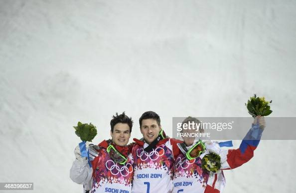 Silver Medallist Canada's Mikael Kingsbury Gold Medallist Canada's Alex Bilodeau and Bronze Medallist Russia's Alexandr Smyshlyaev celebrate on the...