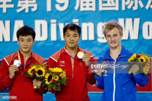 Silver medallist Cao Yuan of China gold medallist He Chong of China and bronze medallist Jack Laughter of Great Britain celebrate during the medal...