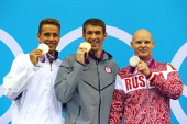 Silver medallist Chad le Cos of South Africa gold medallist Michael Phelps of the United States and silver medallist Evgeny Korotyshkin of Russia...
