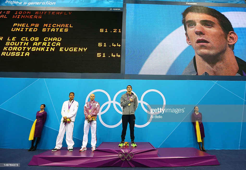 Silver medallist Chad le Cos of South Africa, gold medallist <a gi-track='captionPersonalityLinkClicked' href=/galleries/search?phrase=Michael+Phelps&family=editorial&specificpeople=162698 ng-click='$event.stopPropagation()'>Michael Phelps</a> of the United States, and silver medallist Evgeny Korotyshkin of Russia pose on the podium during the medal ceremony for the Men's 100m Butterfly Final on Day 7 of the London 2012 Olympic Games at the Aquatics Centre on August 3, 2012 in London, England.
