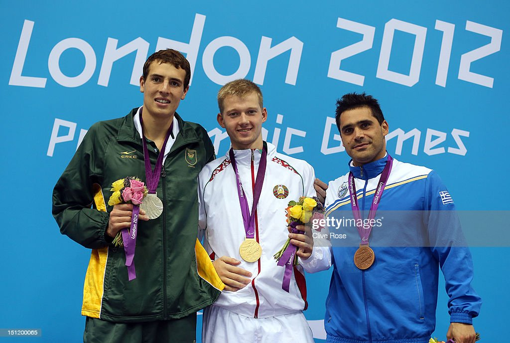 Silver medallist Charles Bouwer of South Africa, gold medallist Ihar Boki of Belarus and bronze medallist Charalampos Taiganidis of Greece pose on the podium during the medal ceremony for the Men's 100m Backstroke - S13 final on day 5 of the London 2012 Paralympic Games at Aquatics Centre on September 3, 2012 in London, England.