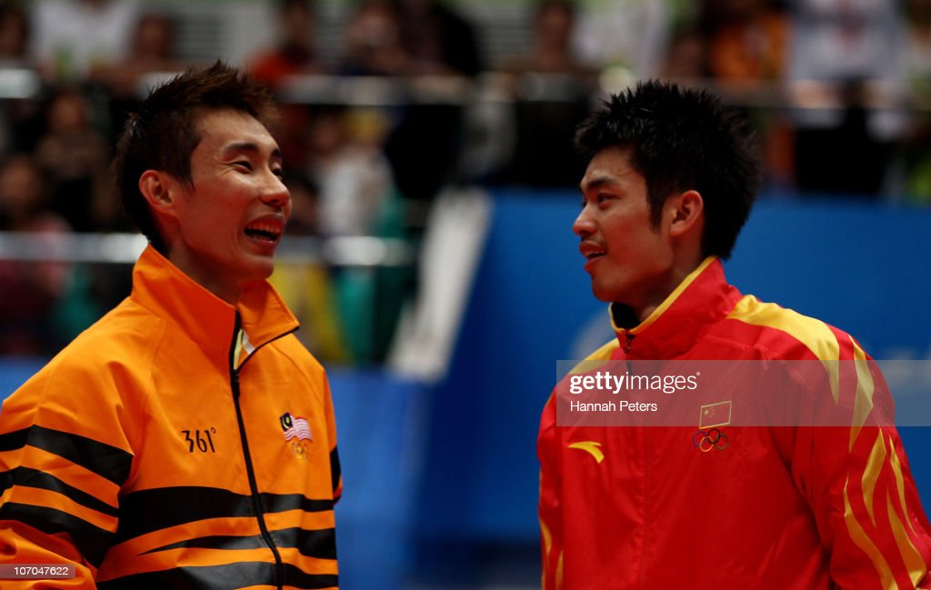 Silver medallist Chong Wei Lee of Malaysia and Gold medallist Dan Lin of China in the Men's Singles Final at Tainhe Gymnasium during nine of the 16th Asian Games Guangzhou 2010 on November 21, 2010 in Guangzhou, China.