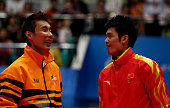 Silver medallist Chong Wei Lee of Malaysia and Gold medallist Dan Lin of China in the Men's Singles Final at Tainhe Gymnasium during nine of the 16th...