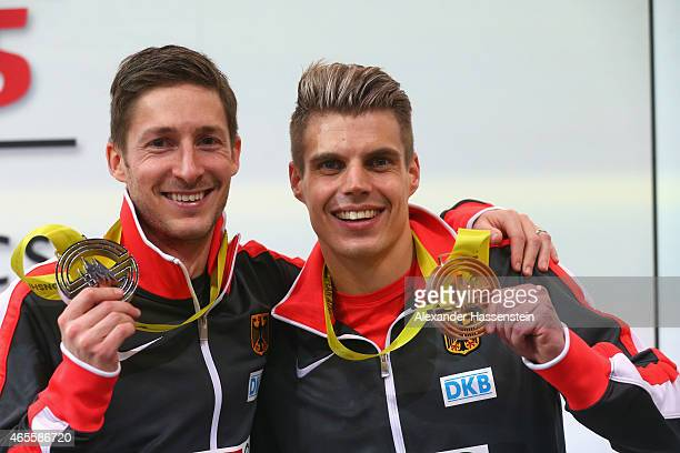 Silver medallist Christian Blum of Germany and bronze medallist Julian Reus of Germany pose on the podium during the medal ceremony for Men's 60...