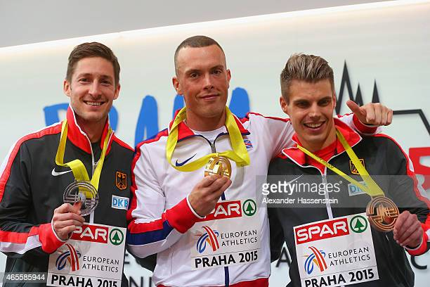 Silver medallist Christian Blum of Germany gold medallist Richard Kilty of Great Britain Northern Ireland and bronze medallist Julian Reus of Germany...