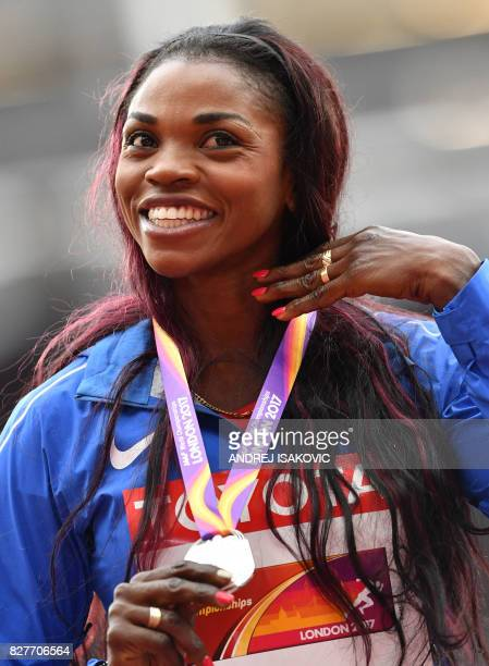 Silver medallist Colombia's Caterine Ibarguen poses on the podium during the victory ceremony for the women's triple jump athletics event at the 2017...