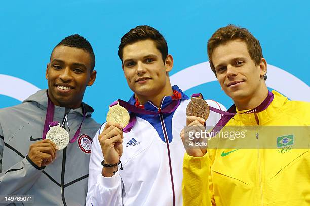 Silver medallist Cullen Jones of the United States Gold medallist Florent Manaudou of France and bronze medallist Cesar Cielo of Brazil pose on the...