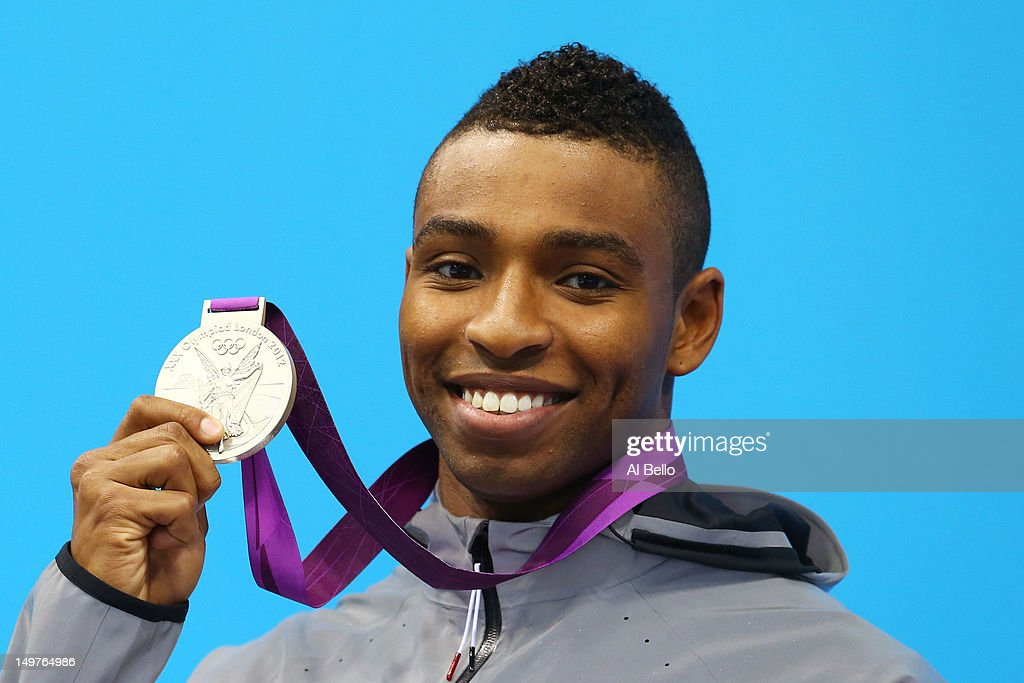 Silver medallist <a gi-track='captionPersonalityLinkClicked' href=/galleries/search?phrase=Cullen+Jones&family=editorial&specificpeople=1047215 ng-click='$event.stopPropagation()'>Cullen Jones</a> of the United States poses on the podium during the medal ceremony for the Men's 50m Freestyle Final on Day 7 of the London 2012 Olympic Games at the Aquatics Centre on August 3, 2012 in London, England.