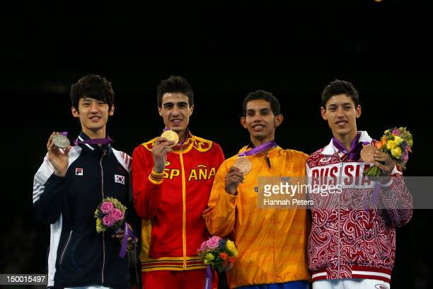 Silver medallist Daehoon Lee of Korea gold medallist Joel Gonzalez Bonilla of Spain bronze medallist Oscar Munoz Oviedo of Colombia and bronze...