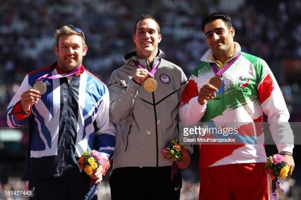 Silver medallist Dan Greaves of Great Britain and gold medallist Jeremy Campbell of the United States and bronze medallist Farzad Sepahvand of the...
