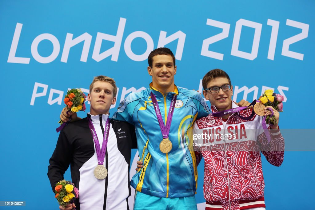 Silver medallist Daniel Sharp of New Zealand, gold medallist Oleksil Fedyna of Ukraine and bronze medallist Roman Dubovoy of Russia pose on the podium during the medal ceremony for the Men's 100m Breaststroke - SB13 final on day 10 of the London 2012 Paralympic Games at Aquatics Centre on September 8, 2012 in London, England.