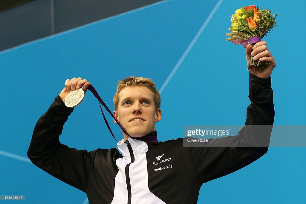 Silver medallist Daniel Sharp of New Zealand poses on the podium during the medal ceremony for the Men's 100m Breaststroke - SB13 final on day 10 of the London 2012 Paralympic Games at Aquatics Centre on September 8, 2012 in London, England.