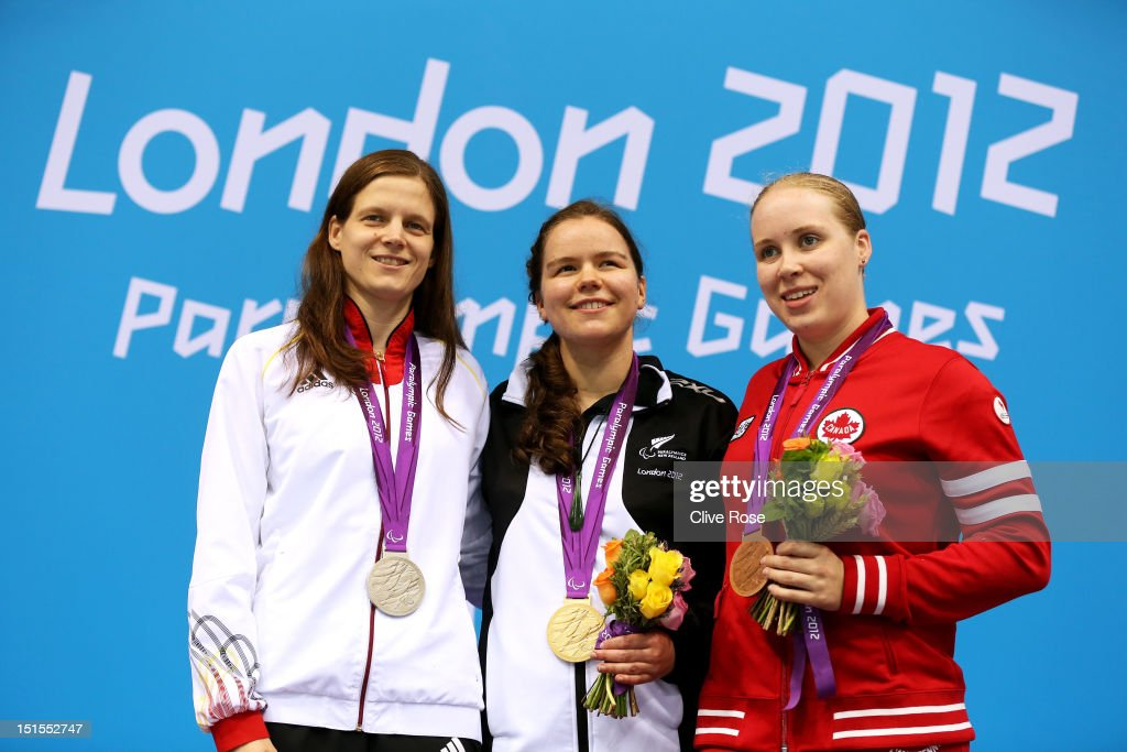 Silver medallist Daniela Schulte of Germany, gold medallist Mary Fisher of New Zealand and bronze medallist Amber Thomas of Canada pose on the podium during the medal ceremony for the Women's 200m Individual Medley - SM11 final on day 10 of the London 2012 Paralympic Games at Aquatics Centre on September 8, 2012 in London, England.