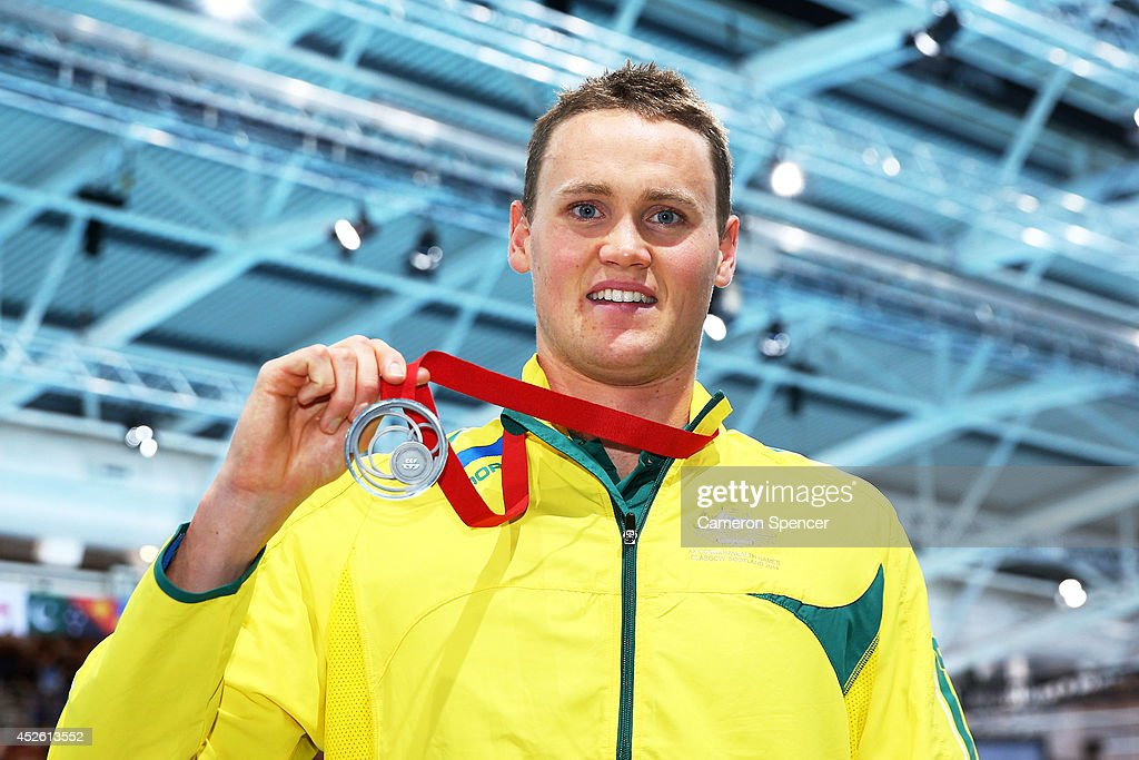 Silver medallist <a gi-track='captionPersonalityLinkClicked' href=/galleries/search?phrase=David+McKeon+-+Swimmer&family=editorial&specificpeople=13412941 ng-click='$event.stopPropagation()'>David McKeon</a> of Australia poses after the medal ceremony for the Men's 400m Freestyle Final at Tollcross International Swimming Centre during day one of the Glasgow 2014 Commonwealth Games on July 24, 2014 in Glasgow, Scotland.