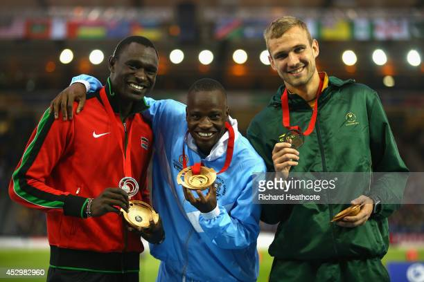 Silver medallist David Rudisha of Kenya gold medallist Nijel Amos of Botswana and bronze medallist Andre Olivier of South Africa pose on the podium...