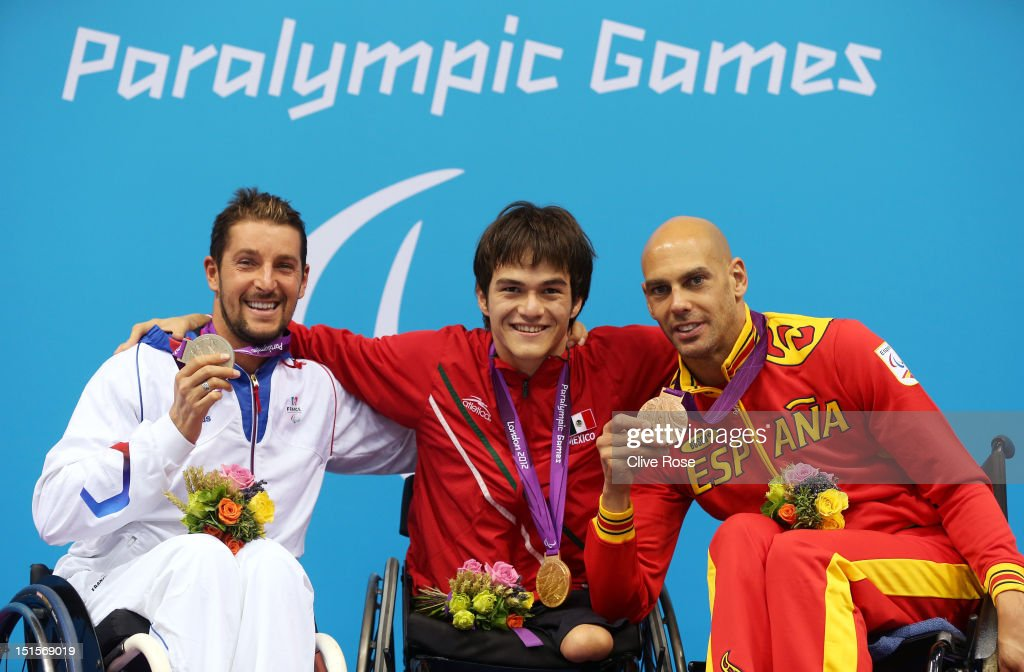 Silver medallist David Smetanine of France, gold medallist Gustavo Sanchez Martinez of Mexico and bronze medallist Richard Oribe of Spain pose on the podium during the medal ceremony for the Men's 200m Freestyle - S4 final on day 10 of the London 2012 Paralympic Games at Aquatics Centre on September 8, 2012 in London, England.