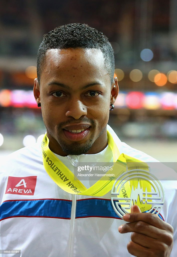 Silver medallist <a gi-track='captionPersonalityLinkClicked' href=/galleries/search?phrase=Dimitri+Bascou&family=editorial&specificpeople=5949069 ng-click='$event.stopPropagation()'>Dimitri Bascou</a> of France on the podium during the medal ceremony for the Men's 60 metre Hurdles during day two of the 2015 European Athletics Indoor Championships at O2 Arena on March 7, 2015 in Prague, Czech Republic.