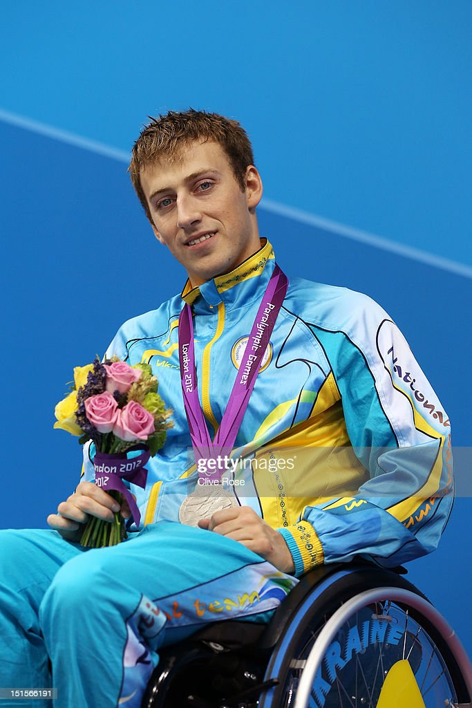 Silver medallist Dmytro Vynohradets of Ukraine poses on the podium during the medal ceremony for the Men's 50m Backstroke - S3 final on day 10 of the London 2012 Paralympic Games at Aquatics Centre on September 8, 2012 in London, England.