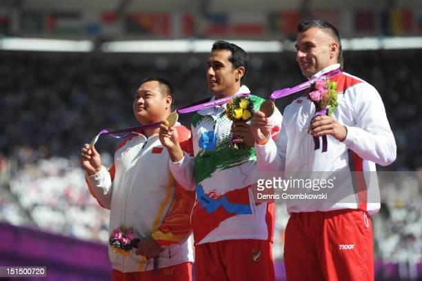 Silver medallist Dong Xia of China gold medallist Javad Hardani of the Islamic Republic of Iran and bronze medallist Tomasz Blatkiewicz of Poland...