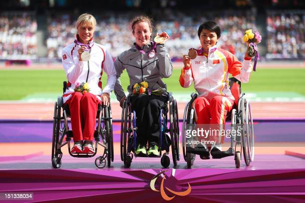 Silver medallist Edith Wolf of Switzerland gold medallist Tatyana Mcfadden of the United States and bronze medallist Lihong Zou of China pose on the...