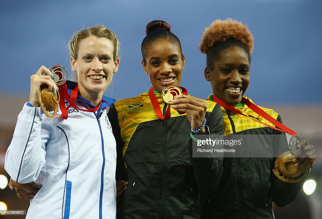 Silver medallist Eilidh Child of Scotland gold medallist Kaliese Spencer of Jamaica and bronze medallist Janieve Russell of Jamaica pose on the...