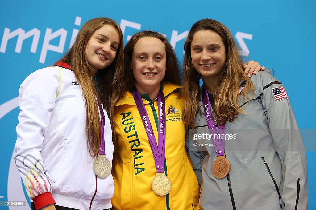 Silver medallist Elena Krawzow of Germany, gold medallist Prue Watt of Australia and bronze medallist Kelley Becherer of the United States pose on the podium during the medal ceremony for the Women's 100m Breaststroke - SB13 final on day 10 of the London 2012 Paralympic Games at Aquatics Centre on September 8, 2012 in London, England.