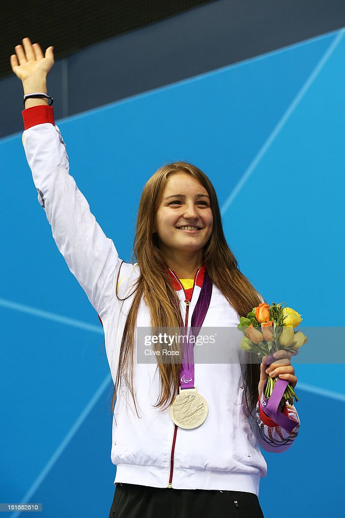 Silver medallist Elena Krawzow of Germany poses on the podium during the medal ceremony for the Women's 100m Breaststroke - SB13 final on day 10 of the London 2012 Paralympic Games at Aquatics Centre on September 8, 2012 in London, England.
