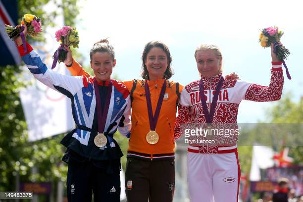 Silver medallist Elizabeth Armitstead of Great Britain gold medallist Marianne Vos of Netherlands and bronze medallist Olga Zabelinskaya of Russia...