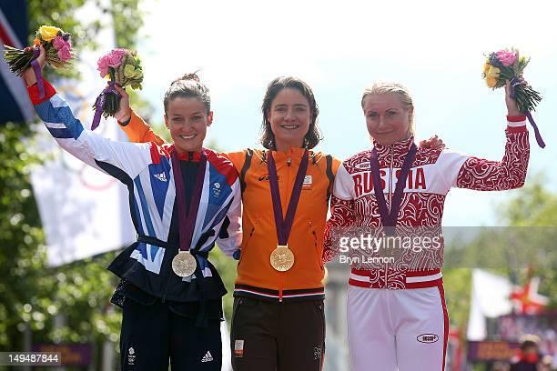 Silver medallist Elizabeth Armitstead of Great Britain gold medallist Marianne Vos of Netherlands and bronze medallist Olga Zabelinskaya of Russia...