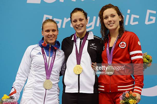 Silver medallist Elodie Lorandi of France gold medallist Sophie Pascoe of New Zealand and bronze medallist Summer Ashley Mortimer of Canada pose on...