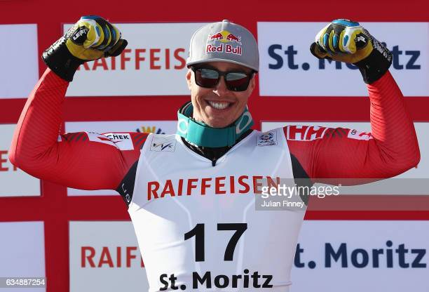 Silver medallist Erik Guay of Canada celebrates during the flower ceremony for the Men's Downhill during the FIS Alpine World Ski Championships on...