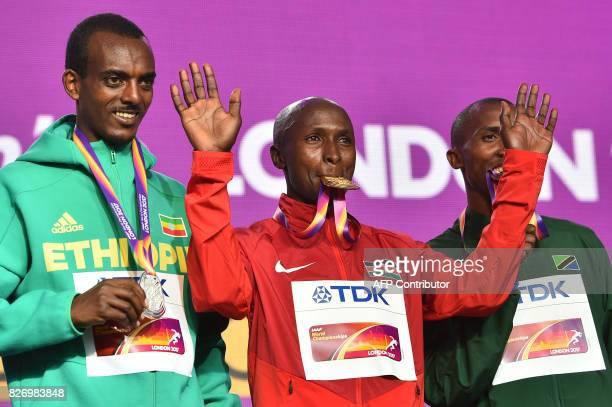 Silver medallist Ethiopia's Tamirat Tola gold medallist Kenya's Geoffrey Kipkorir Kirui and bronze medallist Tanzania's Alphonce Felix Simbu take...