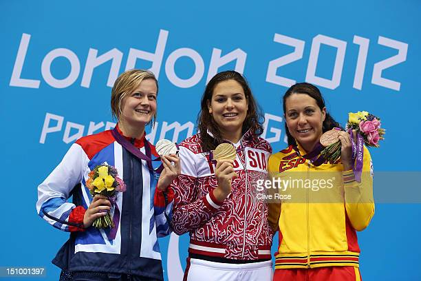 Silver medallist Hannah Russell of Great Britain gold medallist Oxana Savchenko of Russia and bronze medallist Deborah Font of Spain pose on the...
