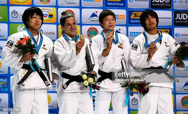 Silver medallist Haruna Asami of Japan gold medallist Paula Pareto of Argentina bronze medallists Jeong Bo Kyeong of South Korea and Ami Kondo of...