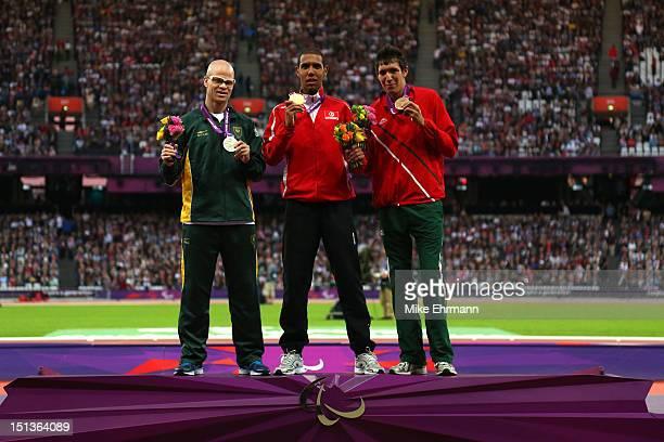 Silver medallist Hilton Langenhoven of South Africa gold medallist Mahmoud Khaldi of Tunisia and bronze medallist Jorge Benjamin Gonzalez Sauceda of...