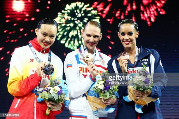 Silver medallist Huang Xuechen of China gold medallist Svetlana Romashina of Russia and bronze medallist Carbonell Ballestero of Spain celebrate...