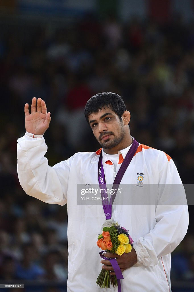 Silver medallist India's <a gi-track='captionPersonalityLinkClicked' href=/galleries/search?phrase=Sushil+Kumar+-+Wrestler&family=editorial&specificpeople=703954 ng-click='$event.stopPropagation()'>Sushil Kumar</a> poses on the podium of the Men's 66kg Freestyle on August 12, 2012 during the wrestling event of the London 2012 Olympic Games.