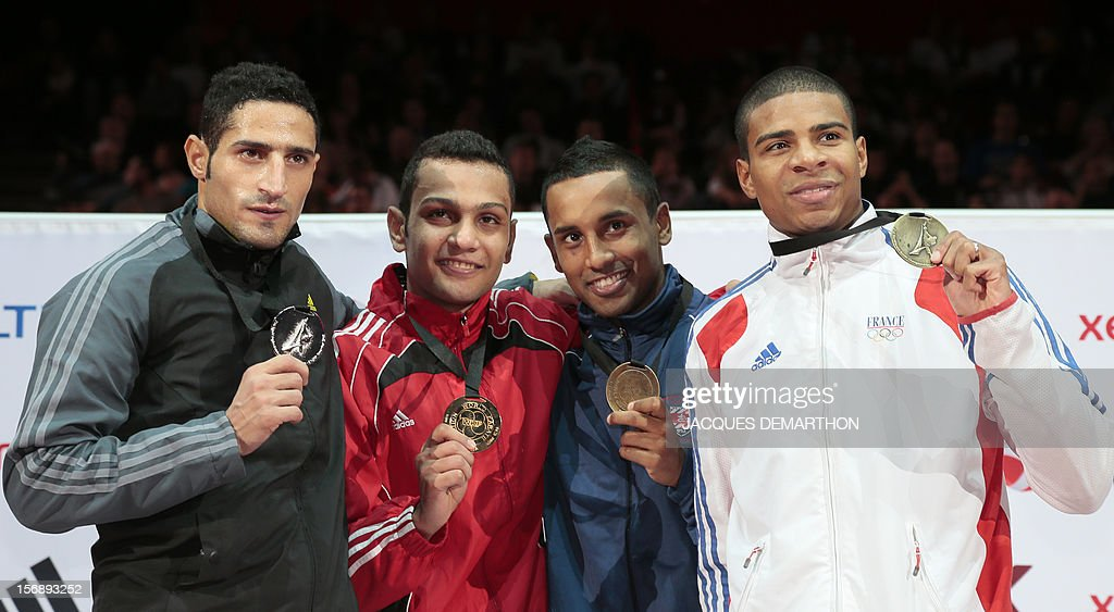 Silver medallist Iran's Saeid Ahmadikaryan, gold medallist Egypt's Magdy Hanafy and bronze medallists US Brian Ramrup and France's Willam Rolle pose with their medals of the Male Kumite under 67Kg category at the Karate world championships on November 24, 2012 in Paris. DEMARTHON
