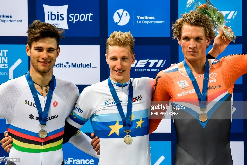 Silver medallist Italian cyclist Filippo Ganna, gold medallist French cyclist Corentin Ermenault and bronze medallist Dutch cyclist Dion Beukeboom stand on the podium of the men's individual pursuit at the European Track Championships Saint Quentin en Yvelines on October 22, 2016. / AFP / PHILIPPE