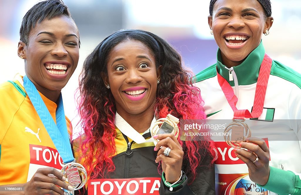 Silver medallist Ivory Coast's Murielle Ahoure, gold medallist Shelly-Ann Fraser-Pryce and bronze medallist Blessing Okagbare pose on the podium during the medal ceremony for the women's 200 metres at the 2013 IAAF World Championships at the Luzhniki stadium in Moscow on August 17, 2013.