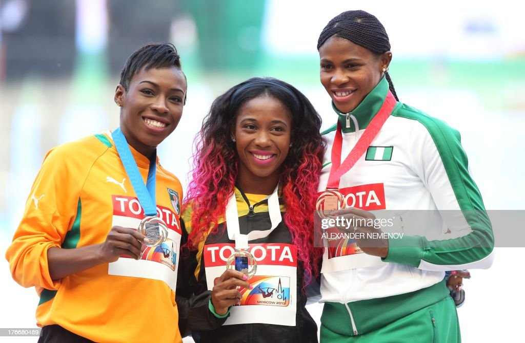 Silver medallist Ivory Coast's Murielle Ahoure, gold medallist Shelly-Ann Fraser-Pryce and bronze medallist Blessing Okagbare pose on the podium during the medal ceremony for the women's 200 metres at the 2013 IAAF World Championships at the Luzhniki stadium in Moscow on August 17, 2013. AFP PHOTO / ALEXANDER NEMENOV