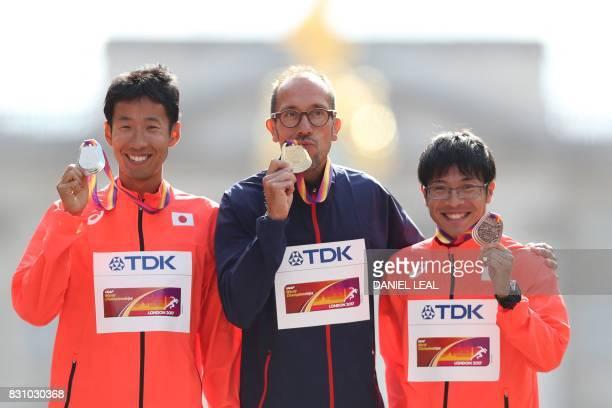 Silver medallist Japan's Hirooki Arai gold medallist France's Yohann Diniz and bronze medallist Japan's Kai Kobayashi pose on the podium during the...