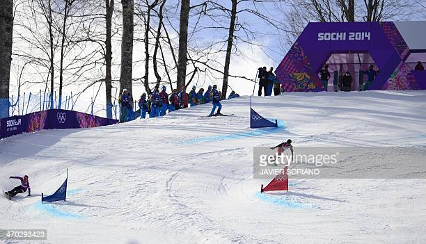 Silver Medallist Japan's Tomoka Takeuchi and Gold Medallist Switzerland's Patrizia Kummer compete in the Women's Snowboard Parallel Giant Slalom...