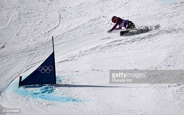 Silver Medallist Japan's Tomoka Takeuchi crashes in the Women's Snowboard Parallel Giant Slalom Final at the Rosa Khutor Extreme Park during the...