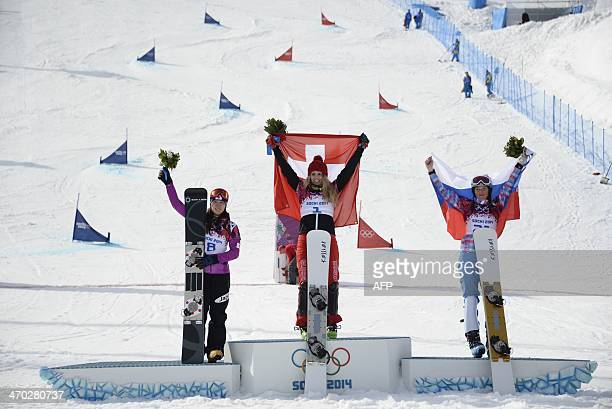 Silver Medallist Japan's Tomoka Takeuchi Gold Medallist Switzerland's Patrizia Kummer and Bronze Medallist Russia's Alena Zavarzina celebrate at the...