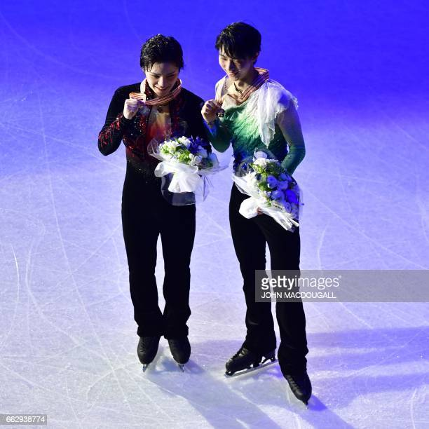 Silver medallist Japans's Shoma Uno and Gold medallist Japan's Yuzuru Hanyu pose after the men's free skating event at the ISU World Figure Skating...