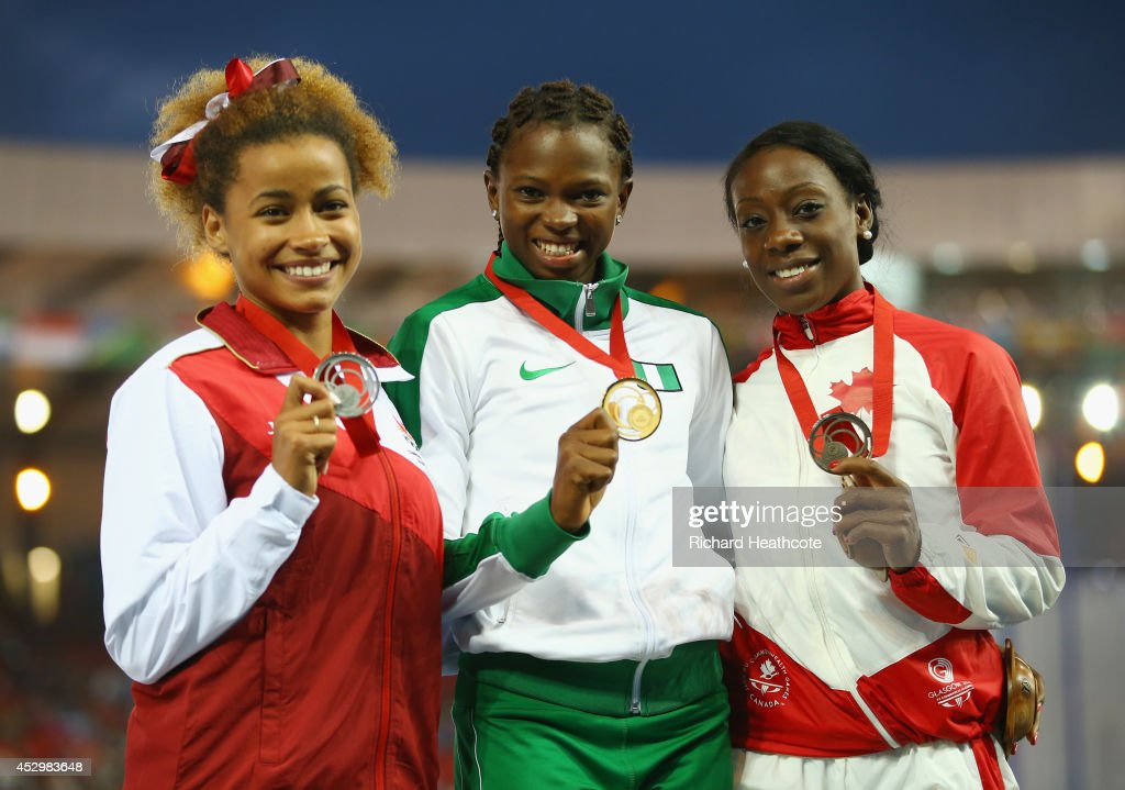 Silver medallist <a gi-track='captionPersonalityLinkClicked' href=/galleries/search?phrase=Jazmin+Sawyers&family=editorial&specificpeople=7926357 ng-click='$event.stopPropagation()'>Jazmin Sawyers</a> of England, gold medallist Ese Brume of Nigeria and bronze medallist <a gi-track='captionPersonalityLinkClicked' href=/galleries/search?phrase=Christabel+Nettey&family=editorial&specificpeople=11241578 ng-click='$event.stopPropagation()'>Christabel Nettey</a> of Canada pose on the podium during the medal ceremony for the Women's Long Jump at Hampden Park during day eight of the Glasgow 2014 Commonwealth Games on July 31, 2014 in Glasgow, United Kingdom.
