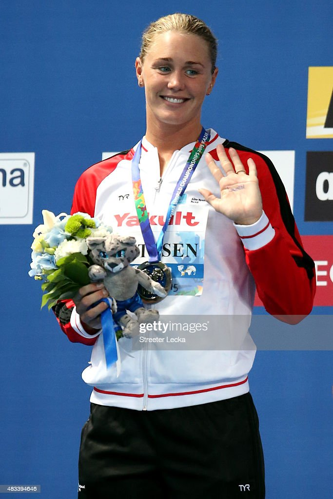 Silver medallist Jeanette Ottesen of Denmark celebrates during the medal ceremony for the Women's 50m Butterfly Final on day fifteen of the 16th FINA World Championships at the Kazan Arena on August 8, 2015 in Kazan, Russia.